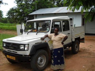 Mama Kisinga with Urambo FDC truck