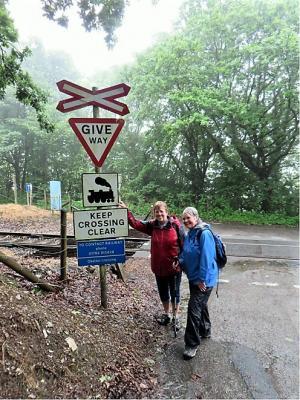 Jo & Maureen about to cross the railway line between Gunnislake & Calstock